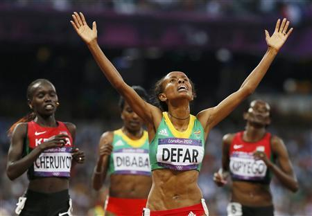 Ethiopia's Meseret Defar reacts after she won the women's 5000m final during the London 2012 Olympic Games at the Olympic Stadium August 10, 2012. REUTERS/Lucy Nicholson