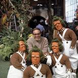 "Mel Stuart,(C) director of the 1971 film ""Willy Wonka & the Chocolate Factory"" poses with the Oompa Loompas characters in the Chocolate room on the set of the film in this undated publicity photograph. Stuart has died at age 83 on August 9, 2012, according to family members. REUTERS/Copyright 2011, Warner Bros. Entertainment Inc./Courtesy Warner Home Video/Handout"