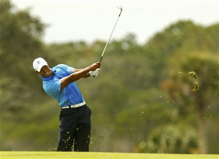 Tiger Woods hits an approach shot on the second hole during the second round of the PGA Championship golf tournament at The Ocean Course on Kiawah Island, South Carolina, August 10, 2012. REUTERS/Chris Keane