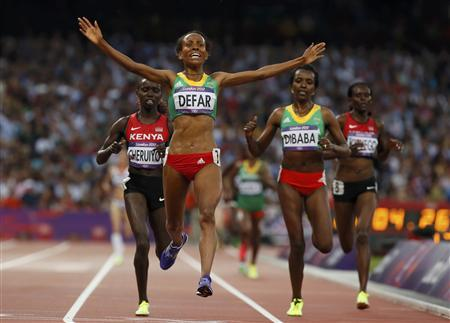 Ethiopia's Meseret Defar celebrates as she crosses the finish line in first place in the women's 5000m final during the London 2012 Olympic Games at the Olympic Stadium August 10, 2012. REUTERS/Lucy Nicholson