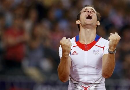 France's Renaud Lavillenie reacts after a successful attempt in the men's pole vault final at the London 2012 Olympic Games at the Olympic Stadium August 10, 2012. REUTERS/Phil Noble