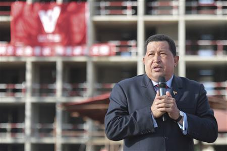 Venezuelan President Hugo Chavez speaks during a visit to an apartment complex under construction in Caracas August 10, 2012. REUTERS/Miraflores Palace/Handout
