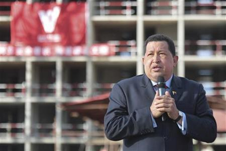Venezuelan President Hugo Chavez speaks during a visit to an apartment complex under construction in Caracas August 10, 2012. An American arrested in Venezuela while entering illegally from Colombia is a former U.S. Marine and is refusing to explain himself under interrogation, President Hugo Chavez said on Friday. REUTERS/Miraflores Palace/Handout (