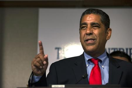 New York State Senator Adriano Espaillat speaks during a news conference to announce a protest against Mexican telecommunications and retail tycoon Carlos Slim Helu in New York, August 6, 2012. REUTERS/Keith Bedford