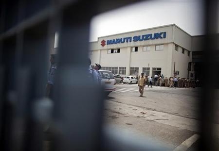 A policeman walks inside the premises of Maruti Suzuki's plant in Manesar, located in Haryana, July 19, 2012. REUTERS/Ahmad Masood/Files