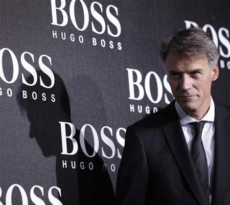 CEO of Hugo Boss Claus-Dietrich Lahrs poses ahead of the BOSS Black fall/winter 2012 fashion show by Hugo Boss in Beijing, May 18, 2012. REUTERS/Soo Hoo Zheyang