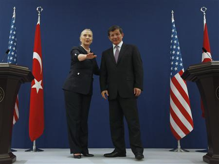 U.S. Secretary of State Hillary Clinton (L) and Turkish Foreign Minister Ahmet Davutoglu pose for the media after their news conference in Istanbul August 11, 2012. REUTERS/Osman Orsal