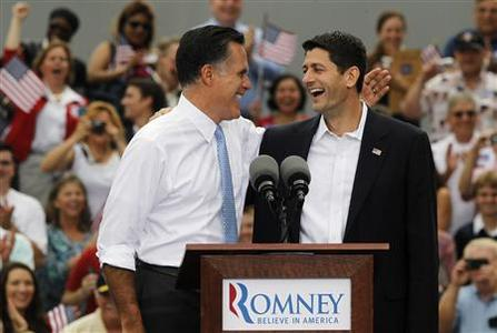 Republican U.S. Presidential candidate Mitt Romney (L) introduces U.S. Congressman Paul Ryan (R-WI) as his vice-presidential running mate during a campaign event at the retired battleship USS Wisconsin in Norfolk, Virginia, August 11, 2012. REUTERS/Jason Reed