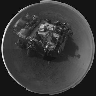 The Curiosity rover is seen in this stitched image taken by its Navigation cameras, located on the now-upright mast, in this picture released by NASA on August 8, 2012. REUTERS/ NASA/JPL/Handout