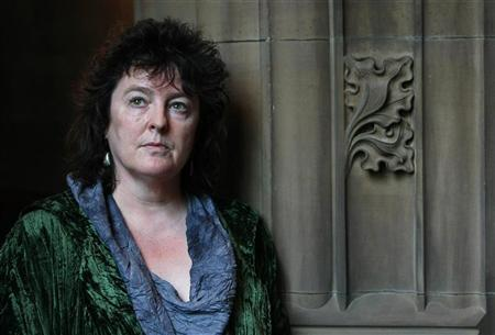Poet laureate Carol Ann Duffy poses for photographers following a news conference at the John Rylands library in Manchester in Manchester, northern England, May 1, 2009. REUTERS/Phil Noble