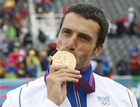 France's Tony Estanguet kisses his gold medal during the victory ceremony for the men's canoe single (C1) event at Lee Valley White Water Centre during the London 2012 Olympic Games July 31, 2012. REUTERS/Suzanne Plunkett