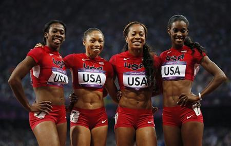 (L to R) Francena McCorory, Allyson Felix, Sanya Richards-Ross and DeeDee Trotter of the U.S. pose for photos after they won the women's 4x400m relay final at the London 2012 Olympic Games at the Olympic Stadium August 11, 2012. REUTERS/Lucy Nicholson
