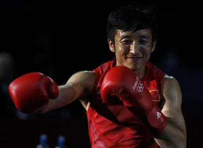 China's Zou Shiming arrives for his Men's Light Fly (49kg) gold medal boxing match against Thailand's Kaeo Pongprayoon at the London Olympics August 11, 2012. REUTERS/Damir Sagolj