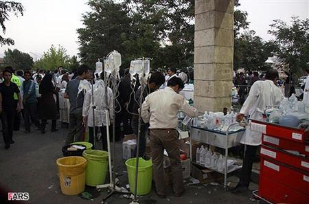 Drips are seen as the wounded are taken to hospital in Ahar August 11, 2012. Two strong earthquakes struck northwest Iran on Saturday, killing 153 people and injuring more than 1,300 as buildings were reduced to rubble, Iranian officials said. REUTERS/Kamel Rouhi/Fars News Agency