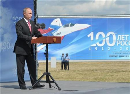 Russian President Vladimir Putin attends an air show dedicated to the 100th anniversary of Russia's Air Force at Zhukovsky outside Moscow August 11, 2012. REUTERS/Alexei Nikolsky/RIA Novosti/Kremlin