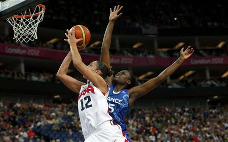 Diana Taurasi (L) of the U.S. puts up a shoot against France's Jennifer Digbeu during their women's gold medal basketball match at the North Greenwich Arena during the London 2012 Olympic Games August 11, 2012. REUTERS/Sergio Perez