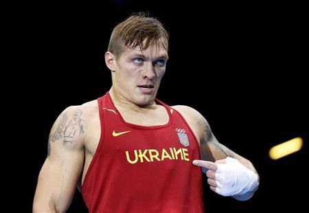 Ukraine's Oleksandr Usyk celebrates after being declared the winner over Italy's Clemente Russo during their Men's Heavy (91kg) gold medal boxing match at the London Olympics August 11, 2012. REUTERS/Damir Sagolj