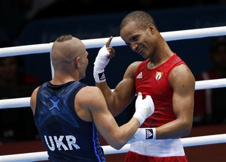 Cuba's Roniel Iglesias Sotolongo (R) talks with Ukraine's Denys Berinchyk after defeating him in their Men's Light Welter (64kg) gold medal boxing match at the London Olympics August 11, 2012. REUTERS/Murad Sezer