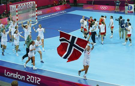 Norway's Linn-Kristin Koren celebrates with flag after defeating Montenegro in their women's gold medal match at the Basketball Arena during the London 2012 Olympic Games August 11, 2012. REUTERS/Cathal McNaughton