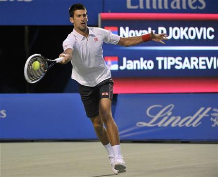 Novak Djokovic of Serbia returns a shot to compatriot Janko Tipsarevic during their semi-final match at the Toronto Masters tennis tournament in Toronto August 11, 2012. REUTERS/Mike Cassese