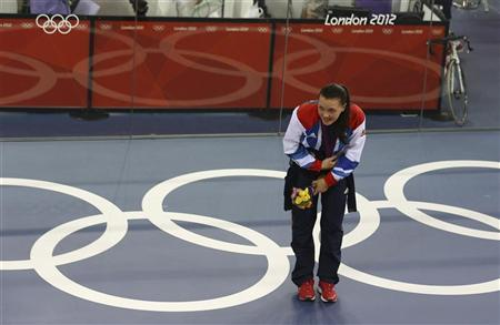 Britain's silver medallist Victoria Pendleton bows to the crowd after the victory ceremony for the track cycling women's sprint event at the Velodrome during the London 2012 Olympic Games August 7, 2012. REUTERS/Luke Macgregor