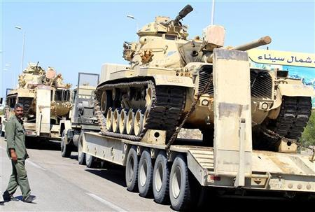 An Egyptian army truck carries tanks and vehicles to Rafah city, some 350 km (217 miles) northeast of Cairo, August 10, 2012 . REUTER/Mohamed Abd El Ghany