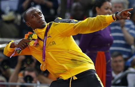 Jamaica's Usain Bolt gestures after receiving his gold medal during the men's 4x100m victory ceremony at the London 2012 Olympic Games at the Olympic Stadium August 11, 2012. REUTERS/Phil Noble
