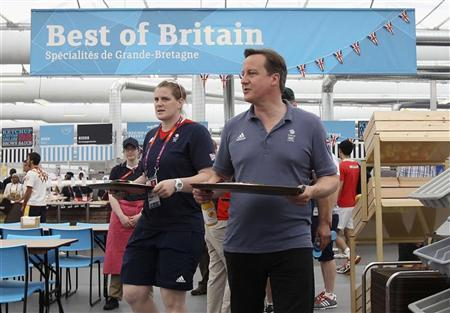 Britain's Prime Minister David Cameron takes lunch with Team GB athletes during his visit to the Olympic Village at the London 2012 Olympic Games August 10, 2012. REUTERS/Scott Halleran/pool