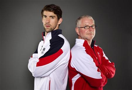 Swimmer Michael Phelps and his coach Bob Bowman (R) pose for a portrait during the 2012 U.S. Olympic Team Media Summit in Dallas, Texas May 13, 2012. REUTERS/Lucas Jackson