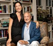 Billionaire investor George Soros and girlfriend Tamiko Bolton are pictured at Soros' residence in Southampton, New York August 11, 2012. Soros had a lot to celebrate on Saturday evening: his 82nd birthday and the engagement to his much younger girlfriend Tamiko Bolton. Soros and Bolton, who met in spring in 2008, formally announced their engagement at a party at Soro's summer home in Southampton, N.Y. attended by a small group of friends and relatives, according to a person familiar with the trader. REUTERS/Myrna Suarez/Handout