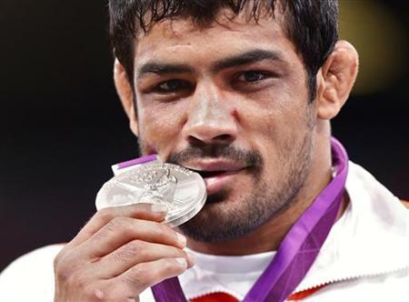 India's Sushil Kumar poses with his silver medal at the podium of the Men's 66Kg Freestyle wrestling at the ExCel venue during the London 2012 Olympic Games August 12, 2012. REUTERS/Grigory Dukor