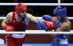 Russia's Egor Mekhontcev (L) fights Kazakhstan's Adilbek Niyazymbetov during their Men's Light Heavy (81kg) gold medal boxing match at the London Olympics August 12, 2012. REUTERS/Damir Sagolj