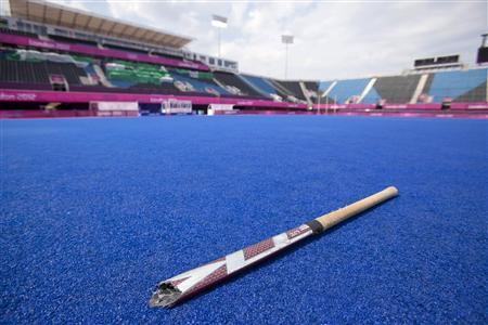 A Broken Hockey Stick Lies In The Middle Of Empty Field Riverbank Area Olympic Park On Final Day London 2012