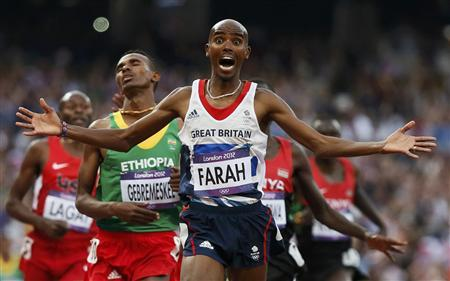Britain's Mo Farah reacts as he wins the men's 5000m final at the London 2012 Olympic Games at the Olympic Stadium in this August 11, 2012 file photo. The first Briton to win a long-distance gold, Farah was only the seventh man to do the Olympic 5,000/10,000 double. To match OLY-END-MOMENTS-2012/ REUTERS/Lucy Nicholson