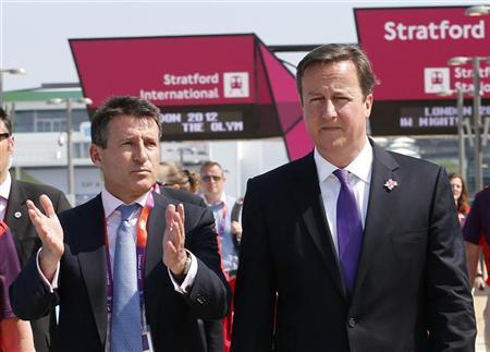 Britain's Prime Minister David Cameron (R) walks with Chairman of the Olympic organising committee (LOCOG) Sebastian Coe at the Olympic Park in Stratford in east London July 26, 2012. REUTERS/Suzanne Plunkett