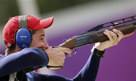 Britain's Peter Robert Russell Wilson ejects spent cartridges during the men's double trap shooting finals at the London 2012 Olympic Games at the Royal Artillery Barracks August 2, 2012. REUTERS/Sergio Moraes