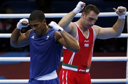 Britain's Anthony Joshua (L) celebrates after he was declared the winner over Italy's Roberto Cammarelle following their Men's Super Heavy (+91kg) gold medal boxing match at the London Olympics August 12, 2012. REUTERS/Damir Sagolj