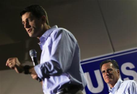 Republican presidential candidate Mitt Romney (R) listens to his vice president selection, U.S. Congressman Paul Ryan (R-WI) speak at a campaign event at the NASCAR Technical Institute in Mooresville, North Carolina August 12, 2012. REUTERS/Shannon Stapleton