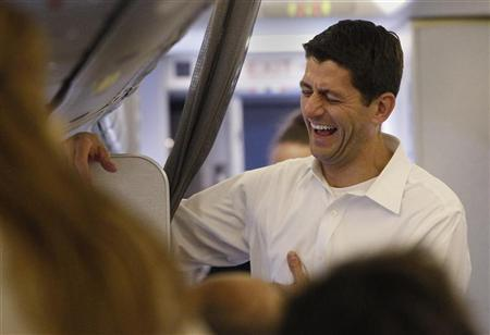 Republican vice president selection U.S. Congressman Paul Ryan (R-WI) smiles aboard a charter flight to Charlotte, North Carolina from Dulles Airport August 11, 2012. REUTERS/Shannon Stapleton