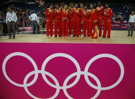 Spain's players pose with their silver medals during victory ceremony at the North Greenwich Arena during the London 2012 Olympic Games August 12, 2012. REUTERS/Sergio Perez
