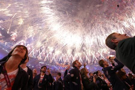 Athletes watch the fireworks show at the closing ceremony of the London 2012 Olympic Games at the Olympic Stadium August 12, 2012. REUTERS/Phil Noble