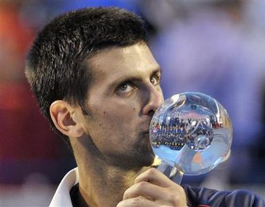 Novak Djokovic of Serbia kisses the championship trophy after defeating Richard Gasquet of France during their mens final match at the Toronto Masters tennis tournament in Toronto August 12, 2012. REUTERS/Mike Cassese