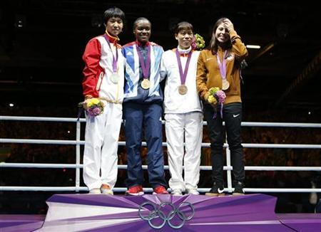 Gold medallist Nicola Adams of Britain (2nd from L) poses with silver medallist Ren Cancan of China (L) and bronze medallists Chungneijang Mery Kom Hmangte of India and Marlen Esparza of the U.S. during the presentation ceremony after the Women's Fly (51kg) gold medal boxing match at the London Olympic Games August 9, 2012. REUTERS/Murad Sezer