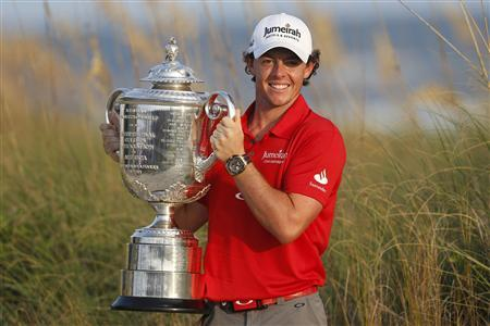 Rory McIlroy of Northern Ireland lifts the Wanamaker Trophy after capturing the PGA Championship at The Ocean Course on Kiawah Island, South Carolina, August 12, 2012. REUTERS/Mathieu Belanger