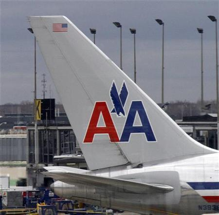An American Airlines plane sits at its gate at O'Hare International airport in Chicago November 29, 2011. REUTERS/Frank Polich