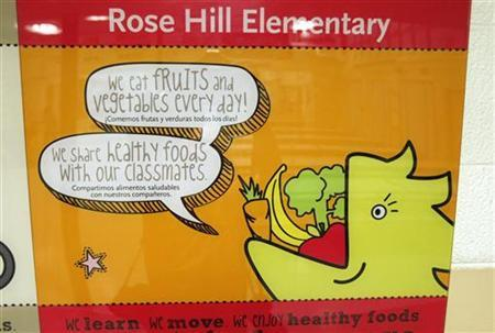 A sign on the wall at Rose Hill Elementary School encourages healthy eating in Commerce City, Colorado, May 1, 2012. REUTERS/Rick Wilking