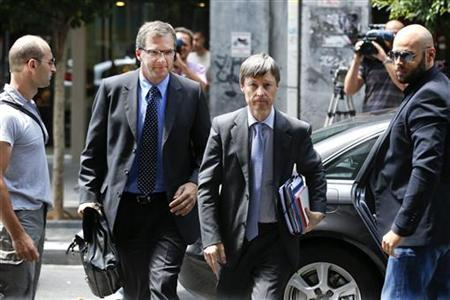 European Central Bank's (ECB) Klaus Masuch (L) and European Commission Director Matthias Mors arrive at the Greek Finance ministry to participate at a meeting in Athens August 2, 2012. REUTERS/Yorgos Karahalis