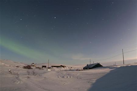 The aurora borealis is seen above residential homes along Osborne Road near Nome, Alaska March 10, 2012. REUTERS/Oscar Avellaneda-Cruz