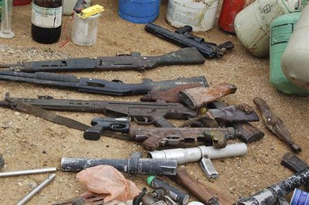 Confiscated weapons are displayed after a military raid on a hideout of suspected Islamist Boko Haram members in Nigeria's northern city of Kano August 11, 2012. REUTERS/Stringer