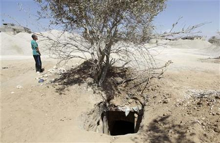 A man walks near a tunnel linking Egypt and the Gaza Strip, at Rafah city, about 350 km (217 miles) northeast of Cairo August 9, 2012. REUTERS/Mohamed Abd El Ghany